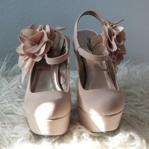 Beige heels with flower on ankle